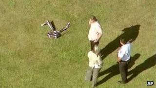 Image from ABC video of investigators standing near a remote controlled toy helicopter that apparently struck and killed a 19-year-old man 5 September 2013