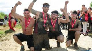 L/Bdr Simpson celebrates with friends after finishing the Spartan Race