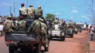 Troops in charge of disarmament ride through Bangui on 5 September 2013