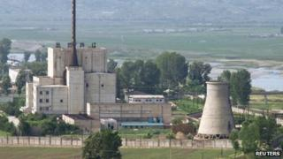 File photo: A North Korean nuclear plant and a cooling tower (right), later demolished, in Yongbyon, 27 June, 2008