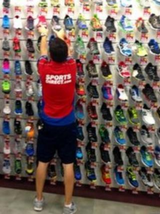 Sports Direct staff member organises trainers