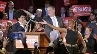 New York City Democratic Mayoral candidate Bill De Blasio his wife Chirlane McCray, right, and son Dante, celebrate after polls closed in New York City's primary election on 11 September 2013
