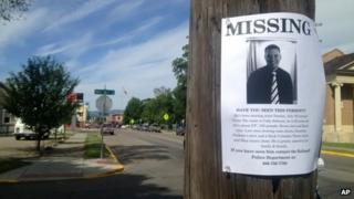 A flyer seeking information regarding Cody Lee Johnson is posted on a Kalispell, Montana 12 July 2013