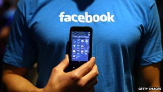 Facebook t-shirt and phone
