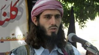 In this Wednesday, May 11, 2011 file photo, American-born Islamist militant Omar Hammami, 27, also known as Abu Mansur al-Amriki, addresses a press conference of the militant group al-Shabab at a farm in southern Mogadishu's Afgoye district in Somalia.