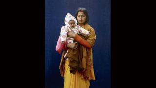 Kumbh Mela Pilgrim - Mamta Dubey and infant by Giles Price
