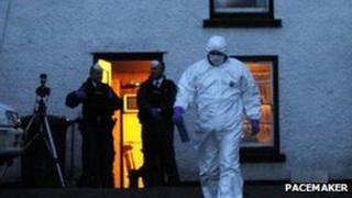 Forensic investigators at the scene of the shooting at the farm in Glenarm