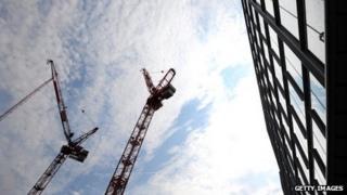 Cranes and a building