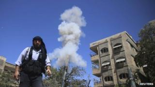 Free Syrian Army member fires a homemade mortar on one of the battlefronts in Jobar, Damascus on 15 September 2013
