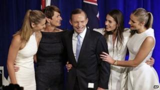 Australian opposition leader Tony Abbott, third left, and his daughters Frances, left, Louise, second right, and Bridget, right, and his wife Margaret, second left, come to the stage to celebrate his election victory in Sydney, 7 September 2013