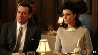 Jon Hamm as Don Draper, left, and Jessica Pare as Megan Draper
