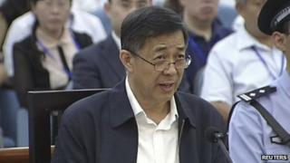 Bo Xilai speaks in a court room at Jinan Intermediate People's Court in Jinan, eastern China's Shandong province, 25 August 2013