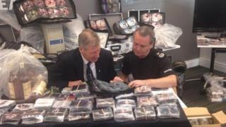 Kenny MacAskill viewing counterfeit goods