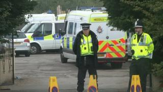 Police at the scene of the raid at Cariad Farm, Peterstone, on Monday