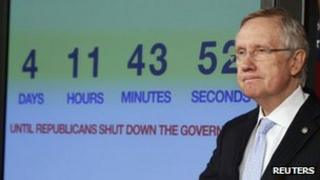 US Senate Majority Leader Harry Reid discusses the potential U.S. government shutdown next to a countdown clock, on Capitol Hill in Washington 26 September 2013
