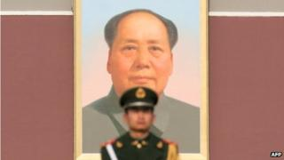 File photo: Paramilitary guard in front of a portrait of Mao Zedong in Tiananmen Square, 15 November 2012