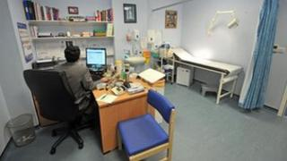 Doctor in consulting room