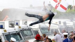 Protester falling from roof