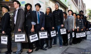 People in a queue outside a job centre highlighting youth unemployment