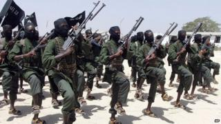 Hundreds of newly trained al-Shabab fighters perform military exercises in the Lafofe area 18km south of Mogadishu, Somalia, taken on 17 February 2011