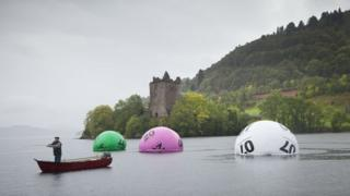 Giant lottery balls in water for publicity photograph