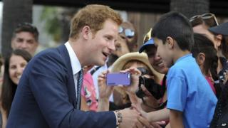 Prince Harry meets crowds in Sydney on his first Royal visit to Australia.