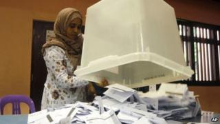 An election official empties a ballot box before the start of counting in Male, Maldives (7 September)