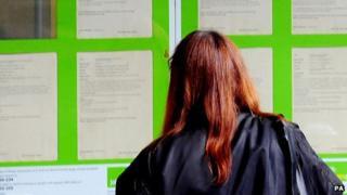 Woman looking at job ads