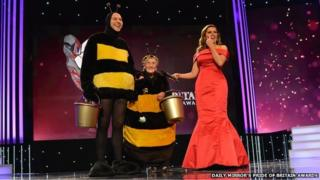 Jean Bishop and David Walliams in bee outfits, with Carol Vordeman