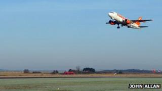 Easyjet plane taking off from Inverness Airport