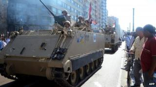 Egyptian troops patrol a street in the northern city of Alexandria (20 September 2013)