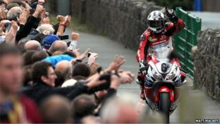 Michael Dunlop receives a great reception from fans as he makes his way back to the winners' enclosure after Sunday's Superbike race on the Isle of Man