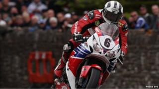 Race winner Michael Dunlop pictured onboard his Superbike powering through St Ninian's crossroads