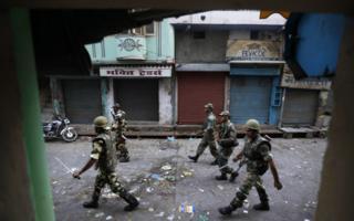 Indian army soldiers patrol curfew in Muzaffarnagar