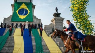 An actor plays the role of Pedro I in front of the independence monument in Sao Paulo on 2 September, 2012