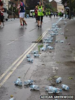 Water bottles on road during Oxford Half Marathon