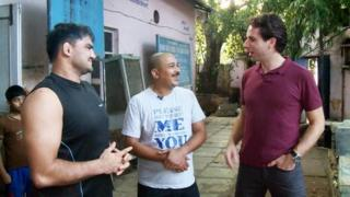 Deepak Prasad (middle) chats with the BBC's Mark Beaumont (right) and wrestling champion Naveen Mor.