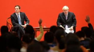 British Chancellor George Osborne and London Mayor Boris Johnson at Peking University in Beijing on October 14, 2013