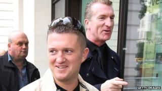 English Defence League leaders Tommy Robinson (C) and Kevin Carroll arrive at Westminster Magistrates Court
