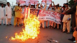 Pakistani activists burn a US flag during a protest against US missile strikes in tribal areas (August 2013)