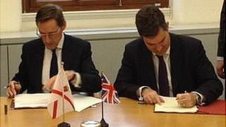 Jersey's Chief Minister Senator Ian Gorst and the Exchequer Secretary to the Treasury David Gauke sign a tax exchange deal