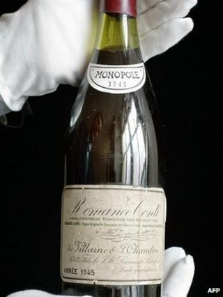 A rare bottle of French 1945 vintage Romanee-Conti wine is displayed at auction