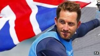 Ben Ainslie celebrates after winning gold in the Finn class sailing at the London 2012 Olympic Games