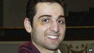 Tamerlan Tsarnaev smiles after accepting the trophy for winning the 2010 New England Golden Gloves Championship in Lowell, Massachusetts 17 February 2010