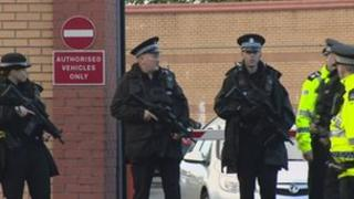 Govan police station with armed police outside