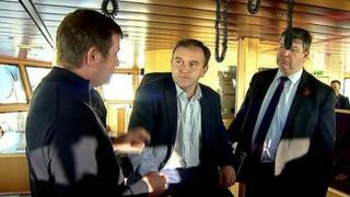 George Eustice (centre) and Alistair Carmichael (right) meet fishermen
