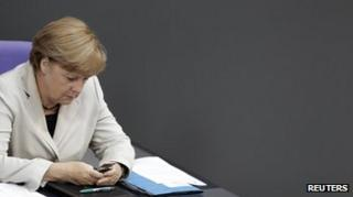 Angela Merkel using mobile