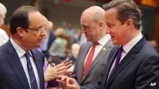 David Cameron talking to French president Francois Hollande