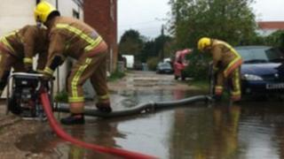 Fire crews pumping water