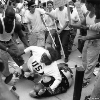 Keshia Thomas protecting the man